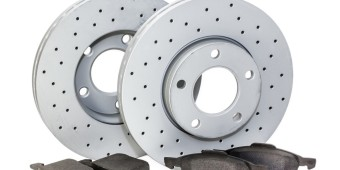Auto parts. brake mechanism for a car on a white background. pads, disk.