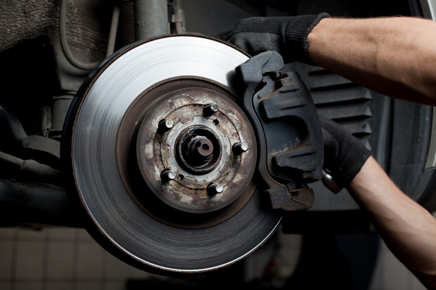 Closeup of car mechanic repairing brake pads
